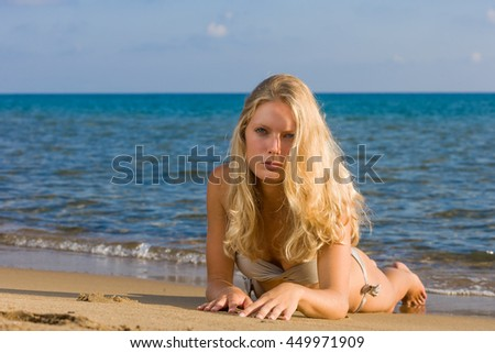 Blonde woman on the beach in Greece