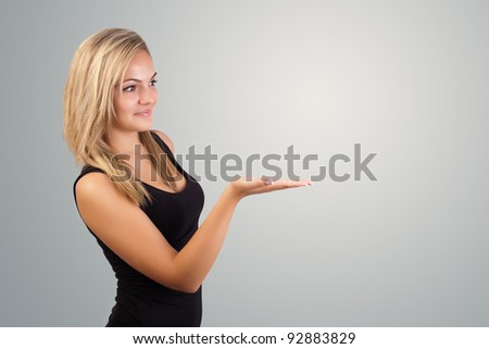 blonde woman presenting hand, copyspace on right