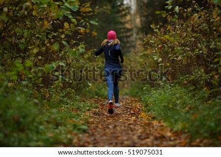 Blonde woman running on trail