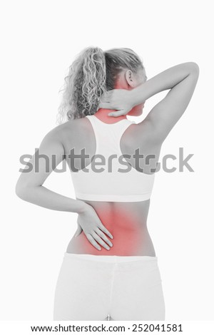 Blonde woman showing pain in her back and in her neck against a white background