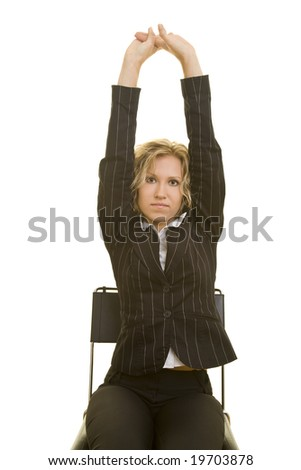 Blonde woman stretching in the office - stock photo