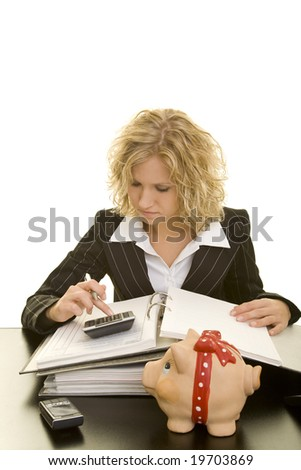 Blonde woman using a calculator - stock photo