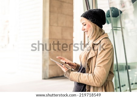 Blonde woman using a digital tablet