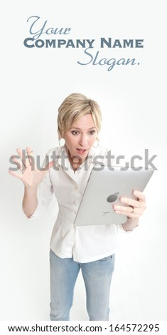 Blonde woman using a PC tablet  - stock photo