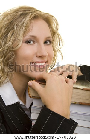 Blonde woman with a stack of books - stock photo