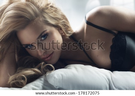 Blonde woman with amazing eyes - stock photo