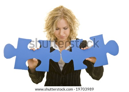 Blonde woman with big jigsaw pieces - stock photo