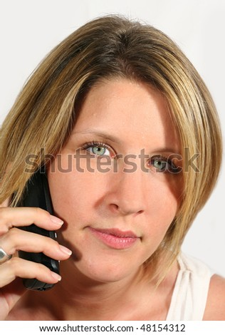 blonde woman with blue eyes on the phone