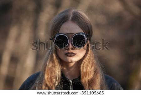blonde woman with glasses - stock photo
