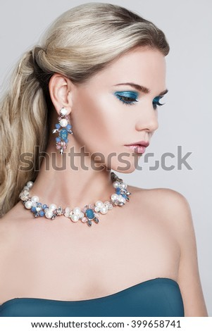Blonde Woman with Long Hair and Makeup - stock photo