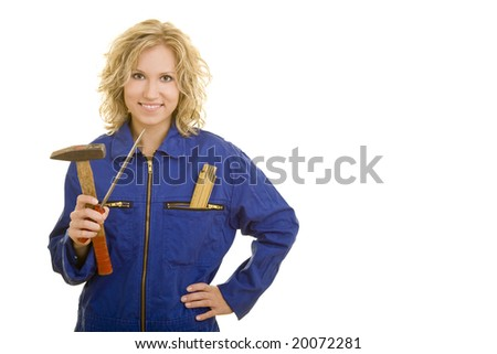 Blonde woman with overall working - stock photo