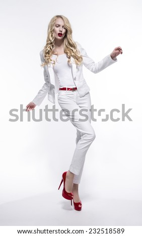 Blonde woman with red lips in white costume