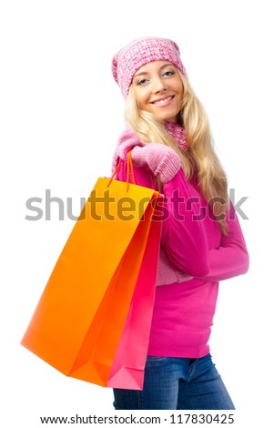 blonde woman with shopping bags over white - stock photo