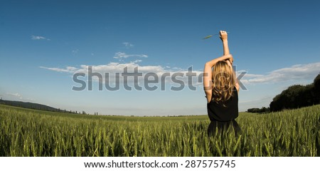 Blonde women feeling freedom - stock photo