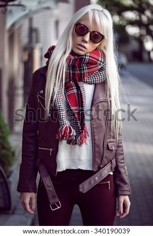 Blonde young girl in posing outdoors - stock photo