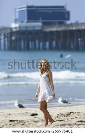 blonde young girl posing outdoors at the beach - stock photo