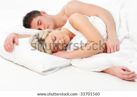 Blonde young girl sleeping with a boy in bed