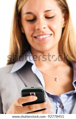 Blonde young woman sending a sms with her cell phone