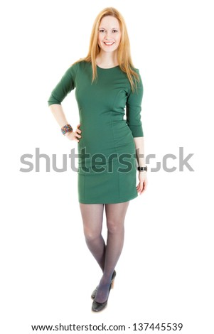 blonde young woman wearing a green dress, black panti-tights and sandals - stock photo