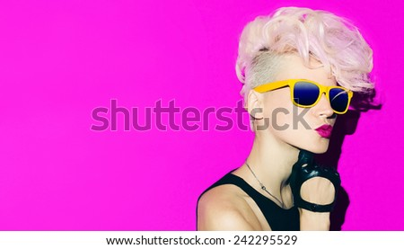 Blondes love pink. Lady rocker glamor party - stock photo