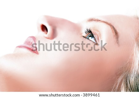 Blondie is having a make up with lip pencil - stock photo