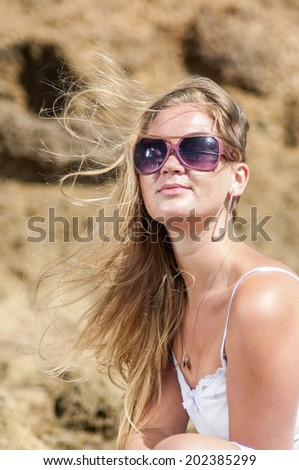 Blondy girl with sunglasses on the beach. Tenerife. Canarian Islands - stock photo