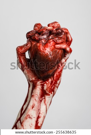 blood and halloween theme terrible bloody hand hold torn bleeding human heart isolated on a - Blood For Halloween