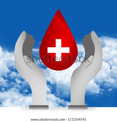 Blood Drop Over The Hand in Blue Sky Background For Blood Donation Concept - stock photo