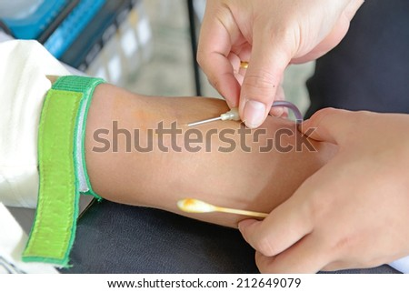 Blood extraction for donation. - stock photo