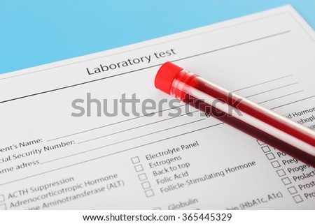 Blood in test tubes and investigation form on the table