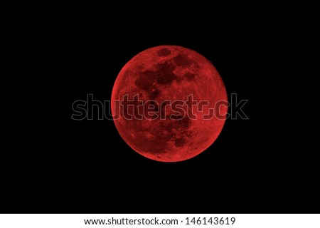 blood moon concept of a red full moon against a black sky - stock photo