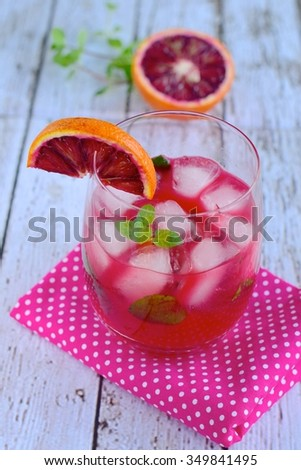 Blood orange cocktail with mint leaf - stock photo