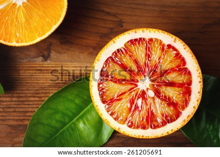 Blood orange fruit close up on wooden table. Top view. - stock photo