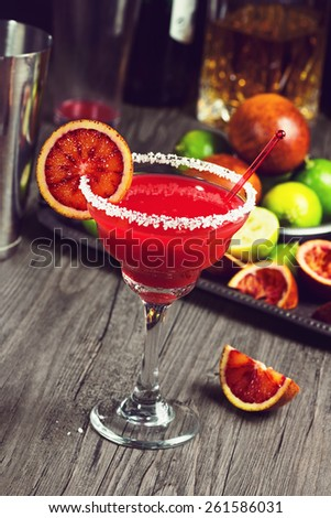 Blood Orange Margarita with Salt: made with Tequila, juice from fresh Blood Oranges and Limes, Triple Sec, and a splash of Agave Syrup. - stock photo