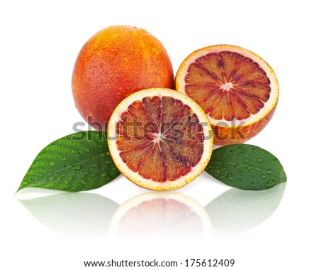 Blood oranges with cut and green leaves isolated on white background. Closeup.