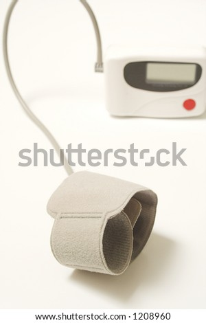 blood pressure appareil close up over white - stock photo