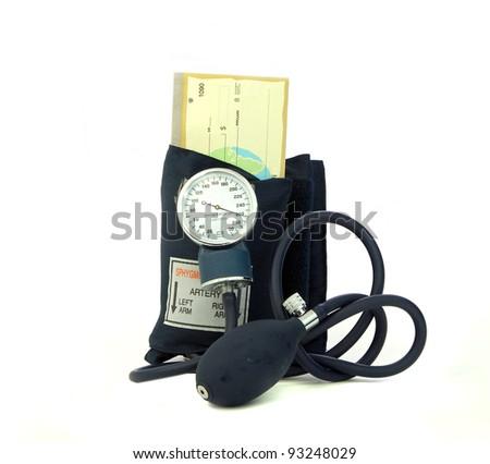 Blood Pressure cuff squeezing checkbook symbolic of a money crunch - stock photo