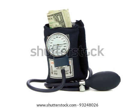 Blood Pressure cuff squeezing money symbolic of a money crunch - stock photo