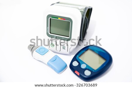 Blood pressure device and device for measuring blood sugar level - stock photo