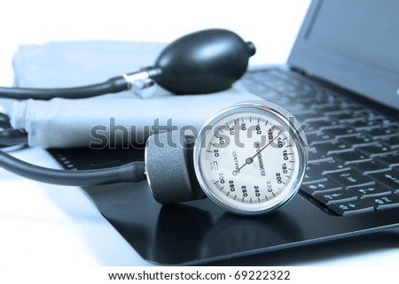 blood pressure instrument on a computer keyboard