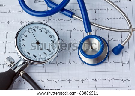 Blood pressure measurement and ECG curve. Sickness caused by high blood pressure. - stock photo