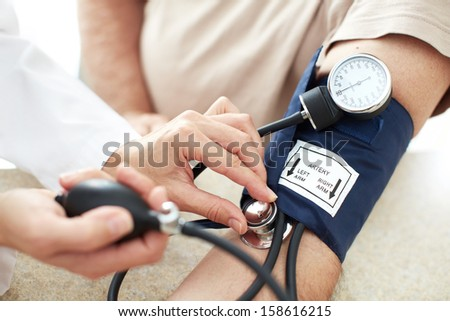 Blood pressure measuring. Doctor and patient.  Health care. - stock photo