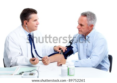 Blood pressure measuring. Doctor and patient.  Isolated on white background. Health care. - stock photo