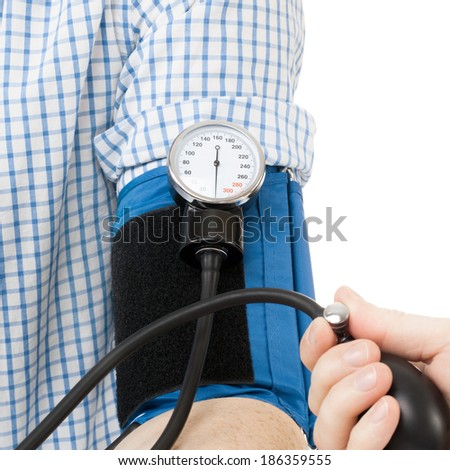 Blood pressure measuring tool. Doctor measuring patients blood pressure - studio shoot - 1 to 1 ratio - stock photo