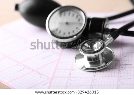 Blood pressure meter, digital tablet and stethoscope, on wooden background - stock photo