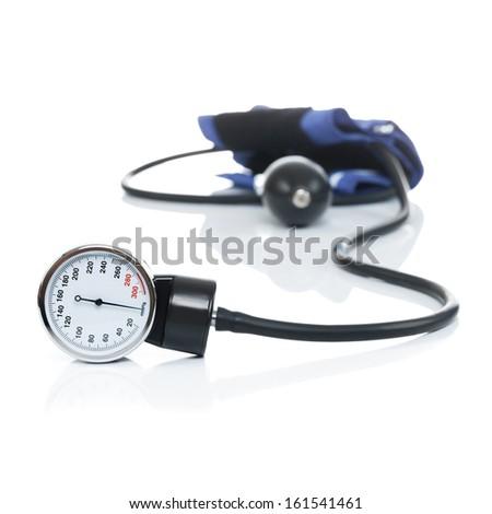 Blood pressure meter medical equipment isolated on white - studio shot - stock photo