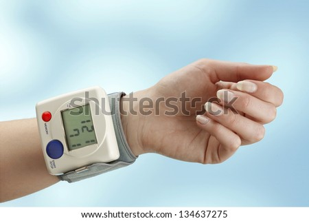 blood pressure meter on woman wrist