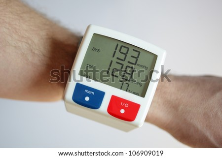 Blood pressure monitor with very high reading concept for illness and heart risk - stock photo