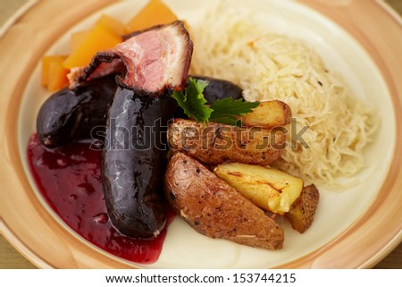 Blood sausage with fried bacon and sauerkraut - stock photo