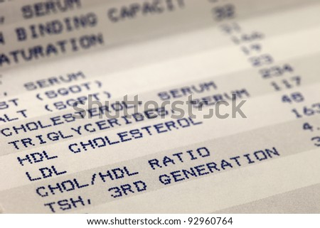 blood screening results printout with focus on cholesterol - detail with a selective focus - stock photo